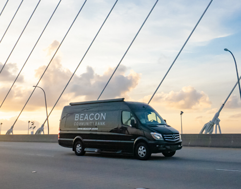 beacon van on road at sunrise